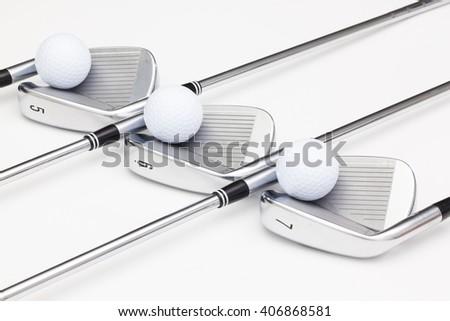 Titanium golf clubs on the white background - stock photo
