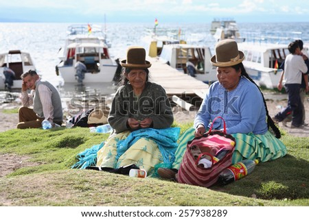 Titicaca lake, Bolivia - January 2: Bolivian women chew coca leaves near ferry Copacabana, Bolivia on January 2,2009.Bolivia obtained exemption from 1961convention,allowing native people to chew coca