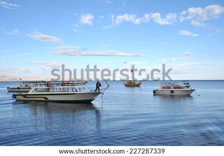 TITICACA LAKE, BOLIVIA - SEPTEMBER 4, 2010:Boats in the town of Copacabana on lake Titicaca. Titicaca, the highest largest fresh water lake in South America , the highest navigable lake in the world.