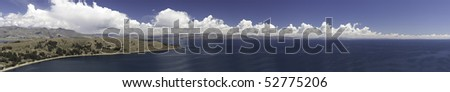 titicaca lake high altitude in andes between Bolivia and Peru near city of Copacabana, isla del sol and Isla de la luna sunny day with nice white clouds in blue sky and water panorama with copy space - stock photo