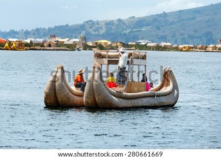 TITICACA, PERU, MARCH 19, 2015: Traditional boat  on lake Titicaca in Peru, South America  - stock photo