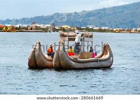 TITICACA, PERU, MARCH 19, 2015: Traditional boat  on lake Titicaca in Peru, South America  - stock photo
