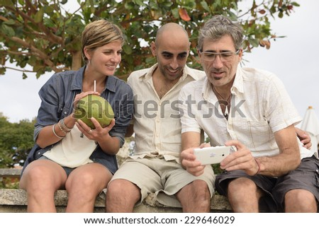 Title:Group of friends with mobile phone - stock photo