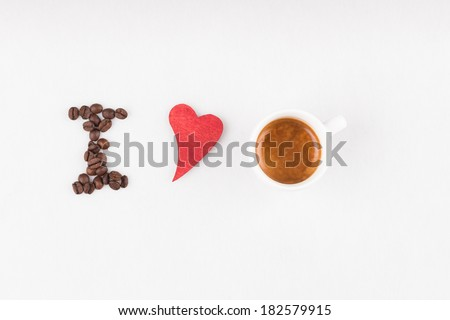 Title I love espresso made of coffee beans, red heart and real espresso - stock photo