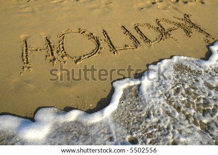 Title on the sand of the beach - stock photo