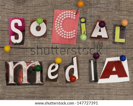 title SOCIAL MEDIA  made of letters from newspapers with pins on the wooden background - stock photo