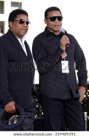 Tito Jackson and Jackie Jackson at the Michael Jackson Hand And Footprint Ceremony held at the Grauman's Chinese Theater, California, United States on January 26, 2012.