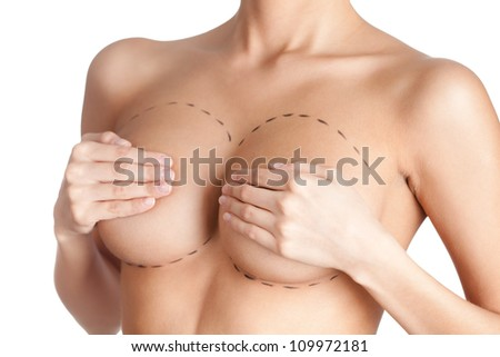 Tits correction. Plastic surgery, isolated, white background - stock photo