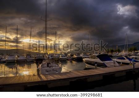 TIVAT, MONTENEGRO - October 8, 2015: Sailing boats in marina at sunset. Tivat, Montenegro - stock photo