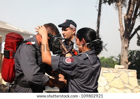 TIVON, ISRAEL - AUGUST 09: Forest fire breaks out in Kiryat Tivon. Rescue workers struggle to prevent further damage. Tivon, Israel August 09, 2012 - stock photo