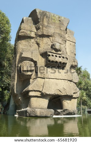 Tlaloc Statue (Aztec God of Rain) Colossal stone made Tlaloc representation placed in The National Museum of Anthropology in Mexico City. - stock photo