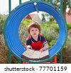 TLittle boy playing on the playground - stock photo