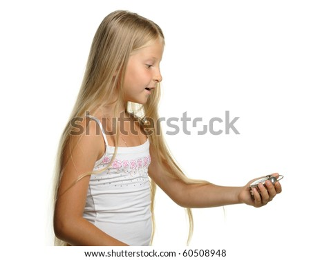 To be late. The girl with amazement looks at an alarm clock. It is isolated on a white background - stock photo