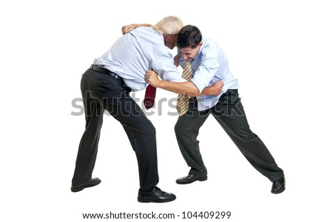 To businessmen wrestling isolated against a white background