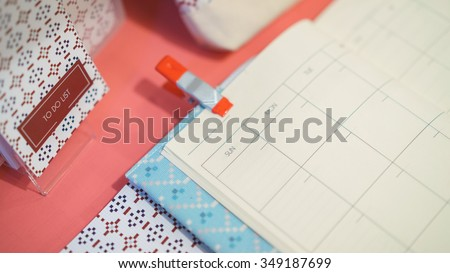 To do list book activity with tilt shift focus filter. - stock photo