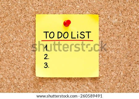 To Do List handwritten on yellow sticky note. - stock photo
