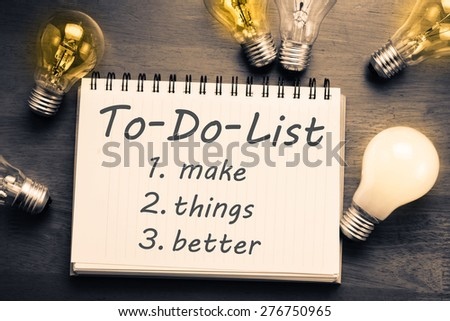 To Do List memo in notebook with light bulbs - stock photo