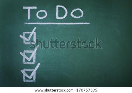 To do list on chalkboard - stock photo