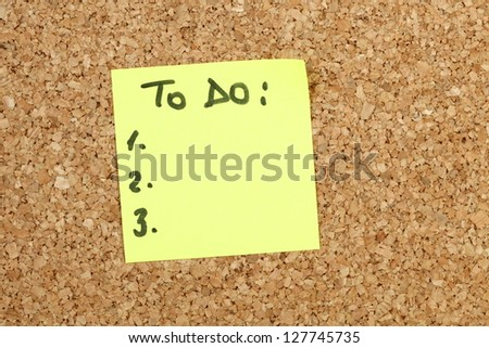 To do list on yellow paper note - stock photo