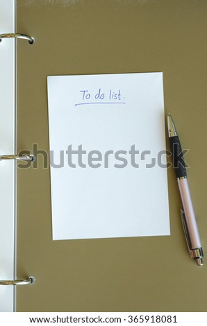 To do list paper with pen on diary book