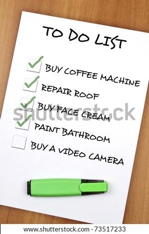 To do list with Buy video camera  not checked - stock photo
