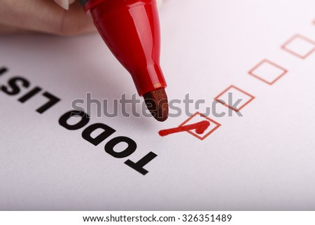 To Do list with check marks isolated on white - stock photo