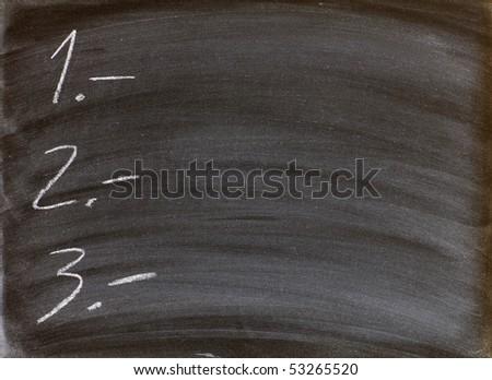 to-do list written on a blackboard - stock photo