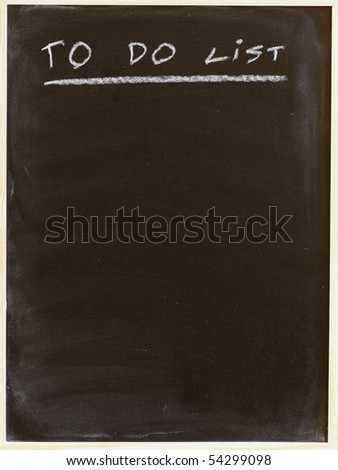 to do list written on a blackboard - stock photo
