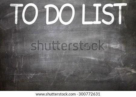 To Do List written on a chalkboard - stock photo