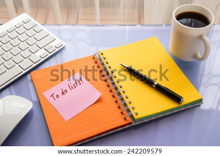 To do lists word on note pad stick on blank colorful paper notebook at home office table, reminder concept - stock photo