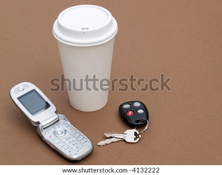 to-go coffee cup, mobile phone and car keys - stock photo