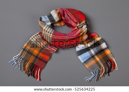 To keep you warm in winter - classic woolen tartan checked scarf on grey background