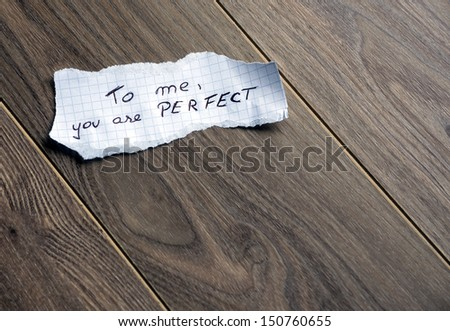 To me, you are Perfect - Hand writing text on a piece of paper on wood background with space for text - stock photo