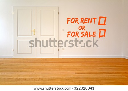 To rent an apartment or buy - Living room with parquet, wooden floors and double door after renovation - stock photo