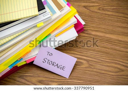 To Storage; The Pile of Business Documents on the Desk - stock photo