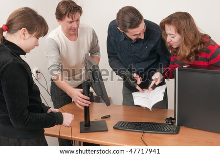 To the girl have entrusted to connect the screen monitor to the new computer and it has called in it a pride and delight. - stock photo