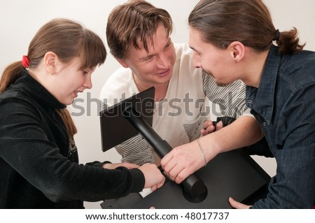To the girl have entrusted to connect the screen monitor to the new computer and it has called in it delight. - stock photo