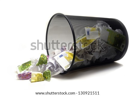 To throw its money with the dustbin by error or ignorance in the business - stock photo