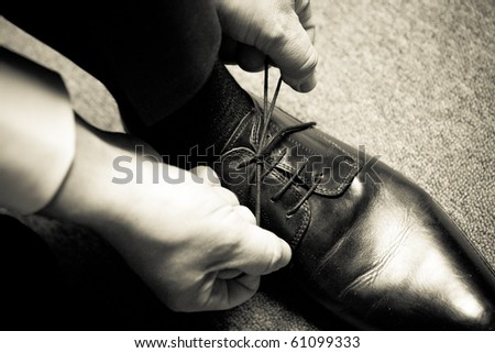 to tie the shoe - stock photo