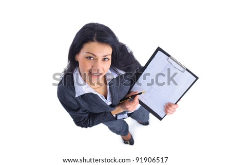 To view of smiling business woman writing in clipboard - stock photo