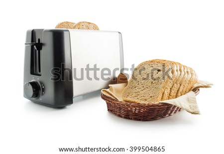 Toast bread and toaster. Wholemeal toast bread slices placed on a cotton cloth napkin in a wicker basket close up arranged with electric toaster isolated on white background. - stock photo