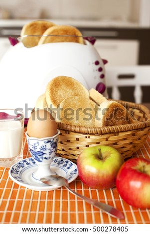 Toast bread, boiled eggs and fruit for breakfast
