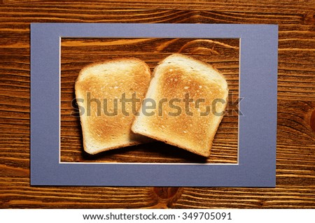 Toast bread sliced on wooden background, top view - stock photo