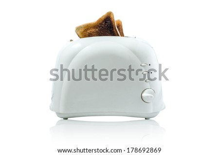 Toast in a toaster Path does not include shadow under toaster - stock photo