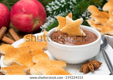 toast in the shape of stars and little men with chocolate and apple butter for Christmas, close-up
