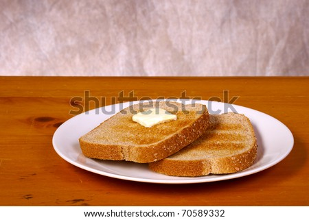 Toast on an old vintage brown table with tan background - stock photo