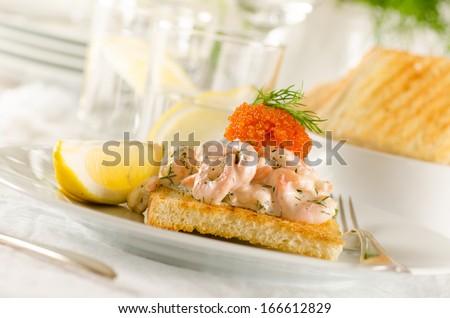 Toast skagen - shrimp and caviar on toast. Classic swedish appetizer - stock photo