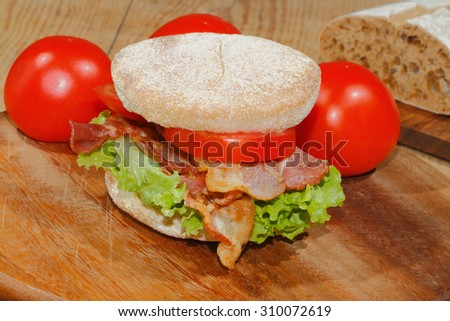 Toast, toast bread with bacon, ham garnished with tomatoes, lettuce and rosemary - stock photo