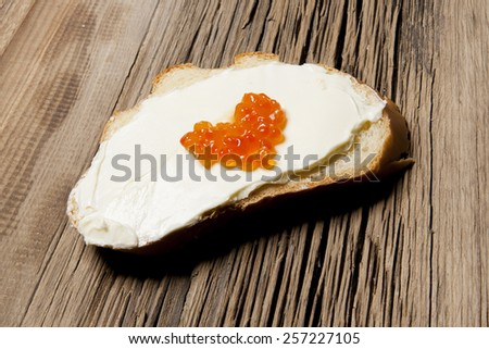 Toast with butter and red caviar in the form of heart - stock photo