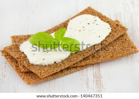 toast with cheese and basil on table
